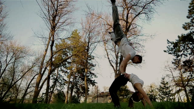 acrobats training in pair - fiducia video stock e b–roll