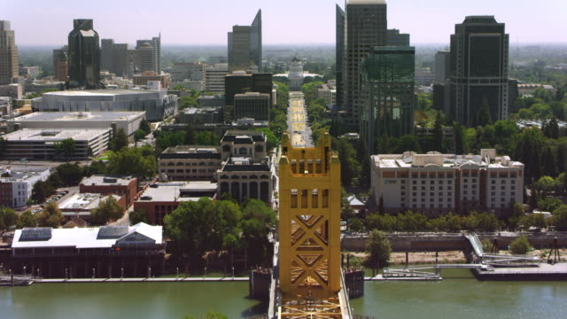 AERIAL Across the Tower Bridge towards The California State Capitol in Sacramento, CA Aerial shot crossing the Tower Bridge and moving toward the California State Capitol in Sacramento, California. Shot in USA. architectural column stock videos & royalty-free footage