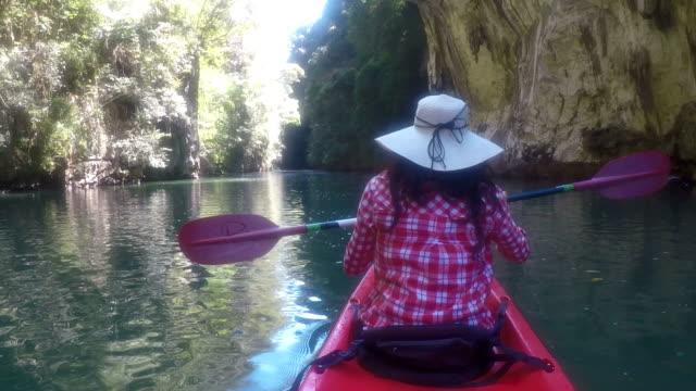 Action Camera POV Of Woman Kayaking In Beautiful Lagoon Back Rear View Girl Paddling On Kayak Boat video