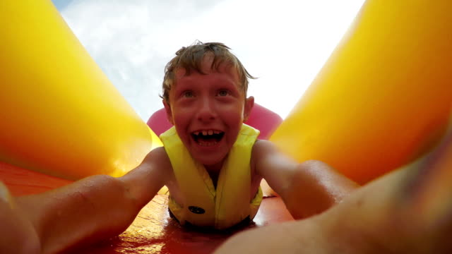 4K action footage:a kid slides down the waterslide video
