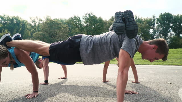 active, activity, body, caucasian, exercise, exercising, fascia, fascial, fit, fitness, gym, gymnastics, happy, health, healthy, outdoor, living, lying, massage, woman, movement, muscle, muscular, people, person, physical, physique, pilates, practicing, r group of well-trained men and women doing push ups in a circle, outdoor in the morning bodyweight training stock videos & royalty-free footage