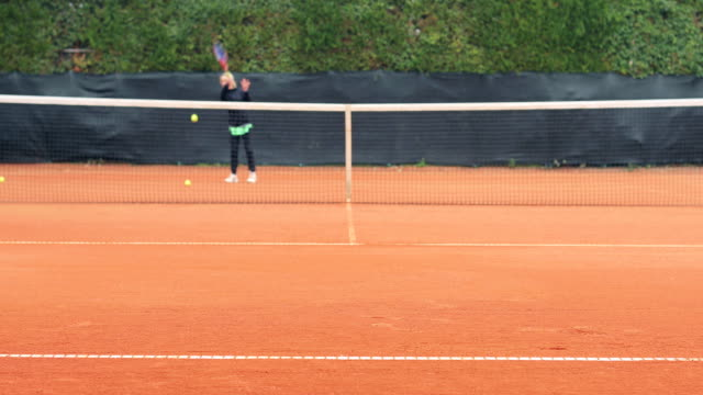 Active Adult Woman Playing Tennis video