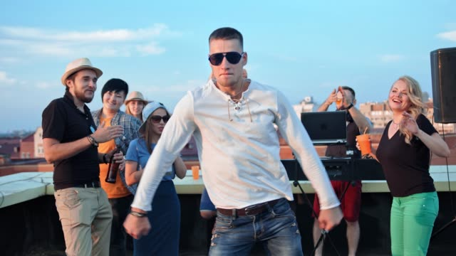 active european man in sunglasses having fun dancing in the middle of dance floor at rooftop party - happy hour stock videos and b-roll footage