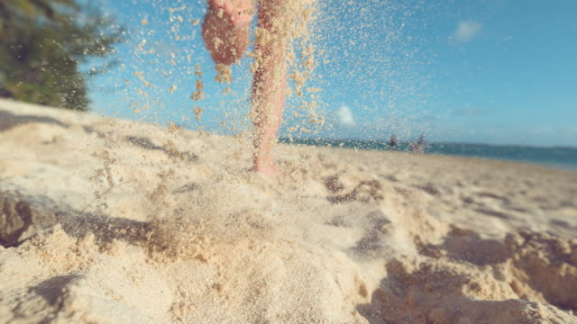 slow motion: active female tourist jogs barefoot down the white sand coast. - wyspa land feature filmów i materiałów b-roll