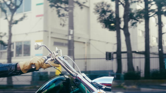 Active japanese senior riding a motorcycle in Tokyo