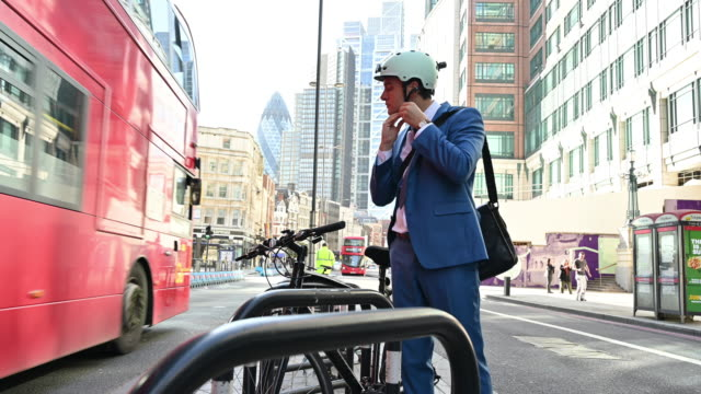 Active London businessman in early 30s commuting by bicycle