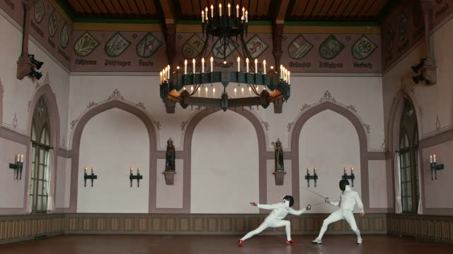 active male fencers dueling in castle - agilità video stock e b–roll