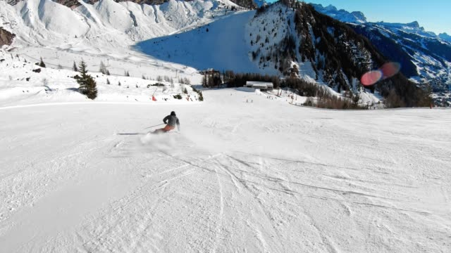 Active man enjoying a sunny day on ski slopes video