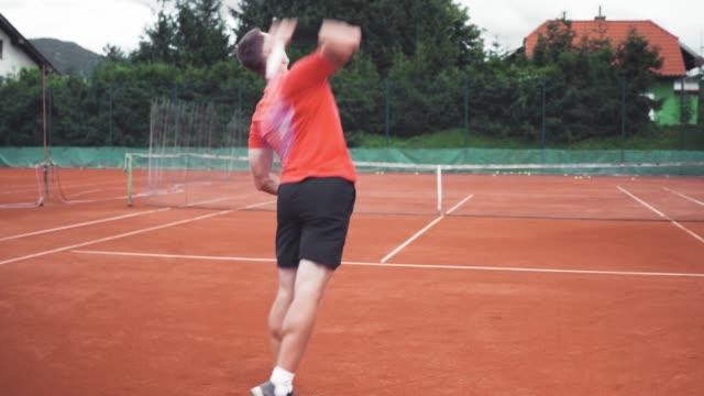 active mature man playing tennis - target australia stock videos & royalty-free footage