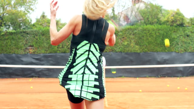 Active Mature Woman Practicing Tennis With Private Coach video