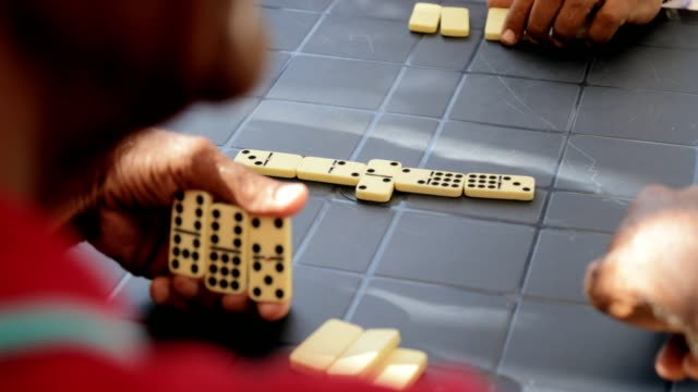 Active Retired Senior Man Playing Domino Game With Friends video
