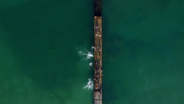 active sea lovers. Beautiful sea swimmers top view video footage. Original aerial drone artistic creative composition - video