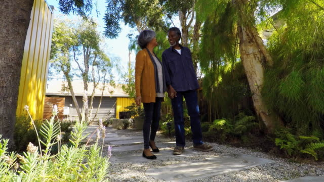 Active Senior African American Couple Walking Through Garden at Home video