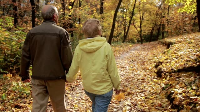 Active senior couple enjoying freetime in park
