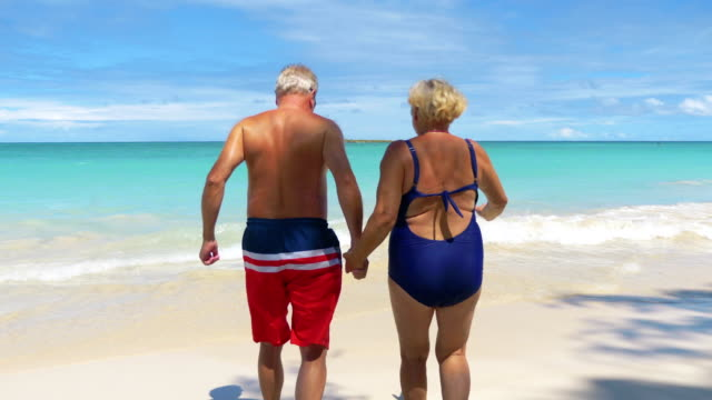 Active Senior Couple Running on Hawaii island in 4K slow motion 60fps