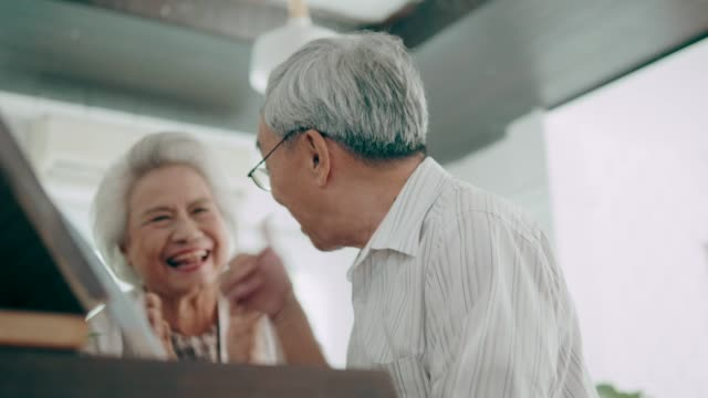 Active senior couple with piano hobbies video