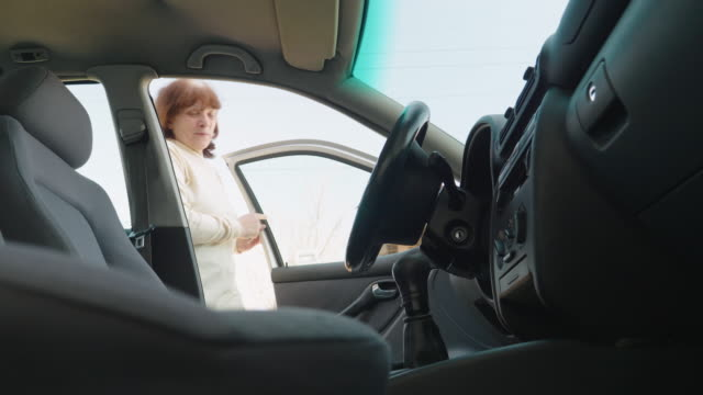 active senior woman taking her car to go to work. - essential workers stock videos & royalty-free footage