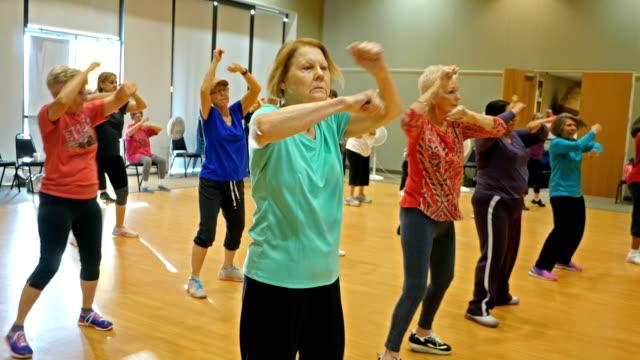 Active senior women have fun in dance class video