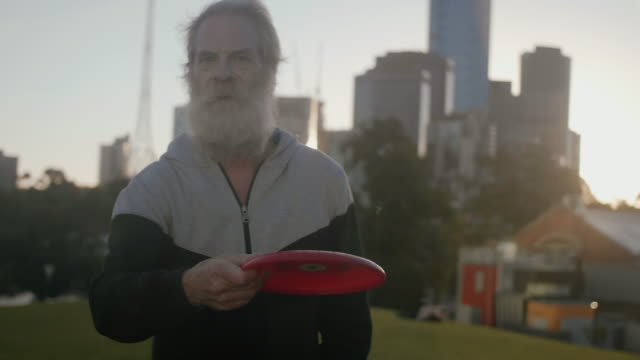 Active seniors playing frisbee video