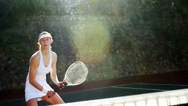 Active sportswoman playing tennis Active sportswoman playing tennis in tennis court teknik stock videos & royalty-free footage