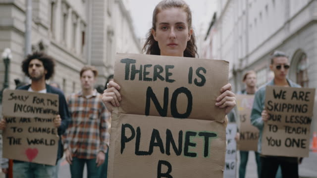Activists protesting on street against climate change