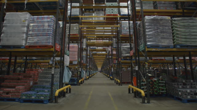Activity in long perspective view of warehouse, shot on R3D video