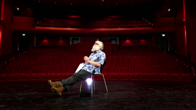 actor, director rehearsal in theatre Actor, director rehearsing his lines on empty stage with one chair and spotlight. actor stock videos & royalty-free footage