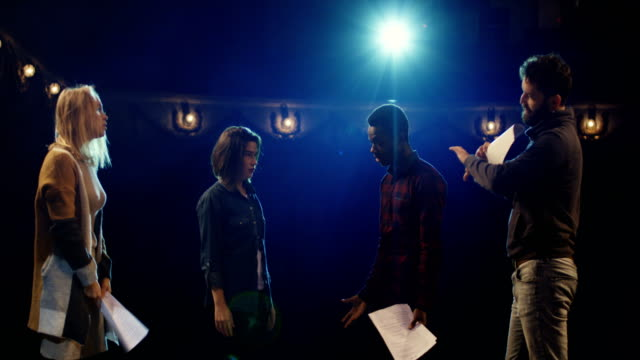 Actors arguing during rehearsal in a theater Medium shot of actors and actresses arguing during rehearsal in a theater actor stock videos & royalty-free footage
