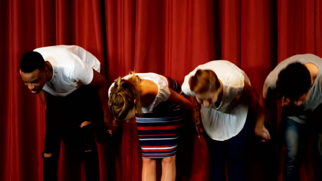Actors bowing on the stage 4k Actors bowing on the stage in theater 4k actor stock videos & royalty-free footage