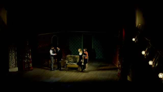 Actors performing a scene in a theater Full shot of actors performing a dramatic scene in a theater actor stock videos & royalty-free footage