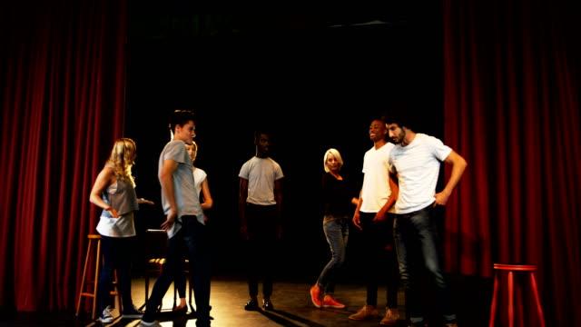 Actors practicing dance on stage 4k Actors practicing dance on stage in theater 4k actor stock videos & royalty-free footage