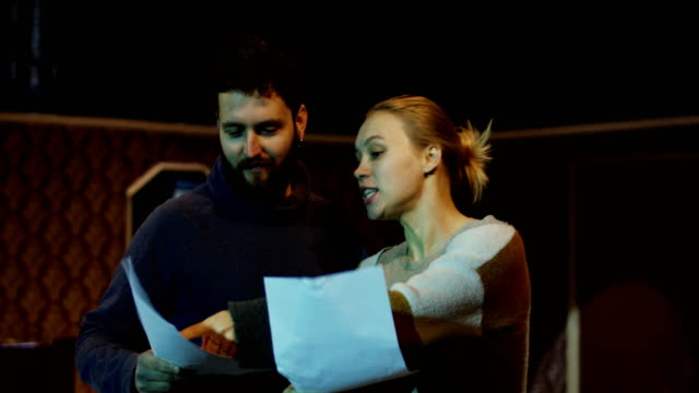 Actors rehearsing a scene in a theater Medium shot of an actor and actress making errors while rehearsing a scene in a theater actor stock videos & royalty-free footage