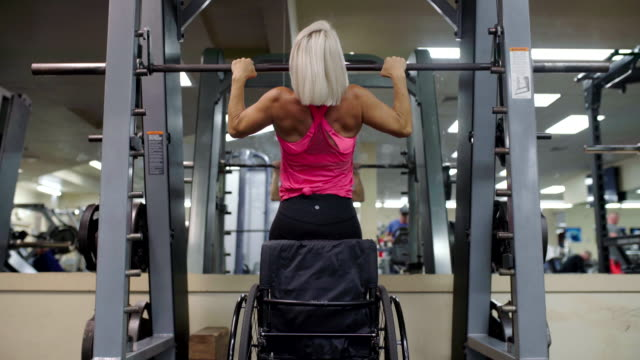 Adaptive athlete in a wheelchair doing pull ups
