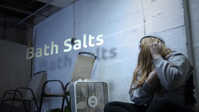 A addict is struggling with withdrawal symptoms with text - Bath Salts video