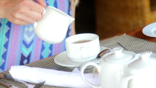 Adding cream to tea video