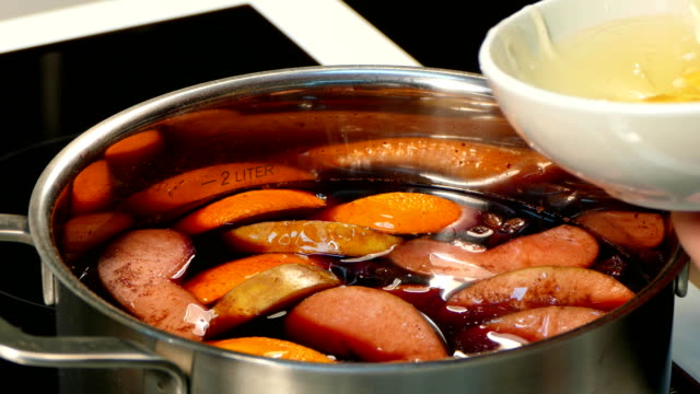 Adding honey to mulled wine video