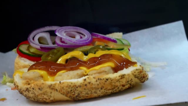 Adding souce in fast food sandwich video