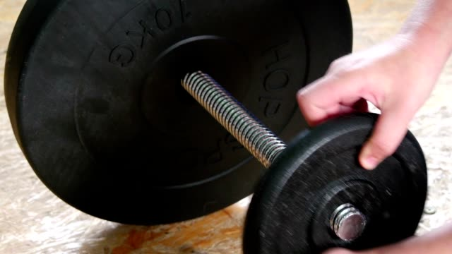 Adding Weights To A Dumbbell video