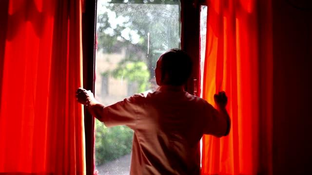 Adjusting window curtains Full HD : Mature men adjusting window curtains during sunny day. covering stock videos & royalty-free footage
