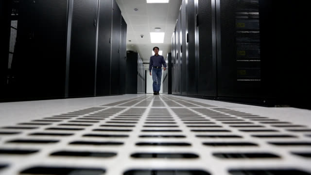 Administrator walking in the data center room video