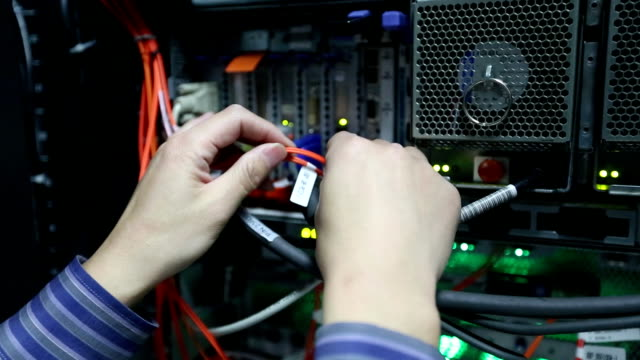 Administrator working in computer server room data center video