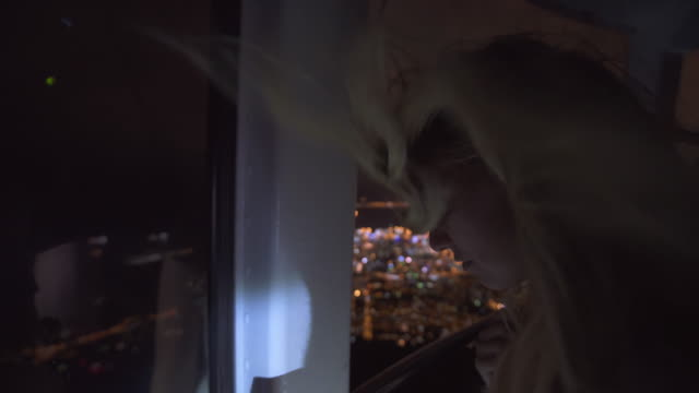 Admiring the city at night from a cable car video