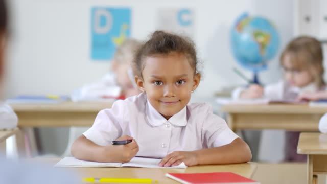 Adorable African-American Schoolgirl Smiling for Camera
