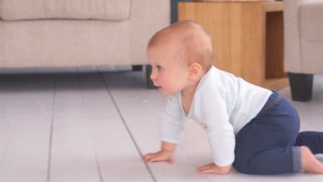 Adorable babygirl crawling at home Adorable babygirl crawling fast at home crawling stock videos & royalty-free footage