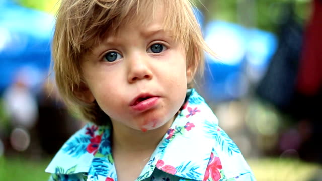 Adorable blue-eyed kid eating a strawberry video