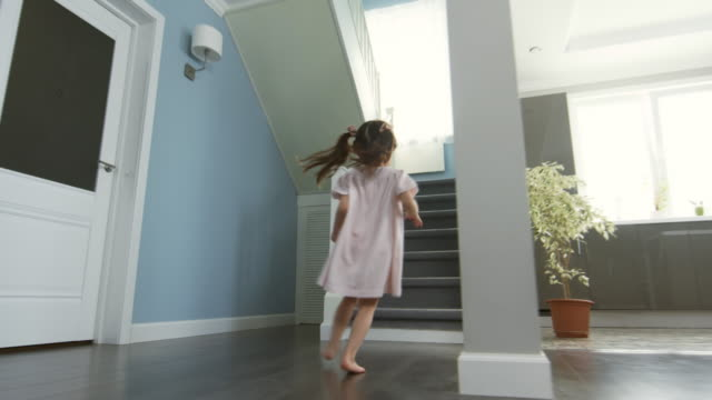 Adorable Girl Running Up Stairs Dolly shot of adorable Asian girl with ponytails running through house and up staircase staircases stock videos & royalty-free footage