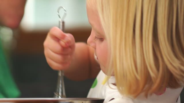 Adorable girl stirs batter video