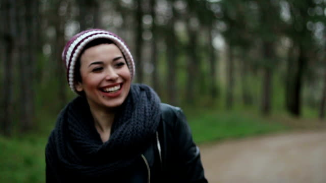 Adorable girl with an wide open smile walking in a park video