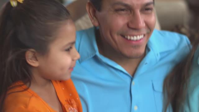 Adorable girls kiss and hug their dad video