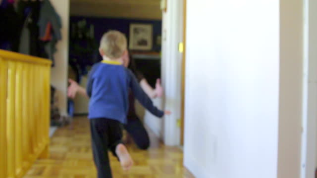Adorable kid runs to his mom video
